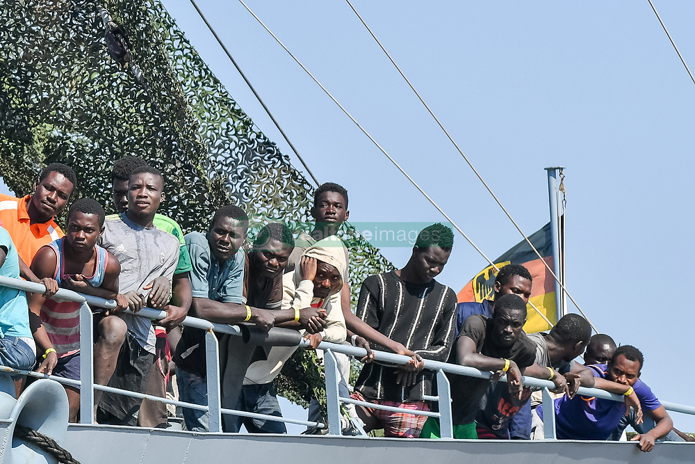 Corigliano Calabro, landing migrants from the German Rhein military ship from which they landed in 990 including 203 unmarried minors and children, 191 women and 2 whole Syrian families. Most of the refugees come from Africa. In the photo a landing moment. 15/07/2017, Corigliano Calabro, Italy