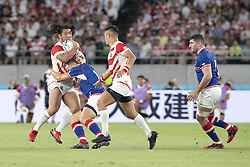 September 20, 2019, Tokyo, Japan: Japan's Shota Horie is tackled by Russia's Yury Kushnarev during the Rugby World Cup 2019 Pool A match between Japan and Russia at Tokyo Stadium. Japan defeats Russia 30-10. (Credit Image: © Rodrigo Reyes Marin/ZUMA Wire)