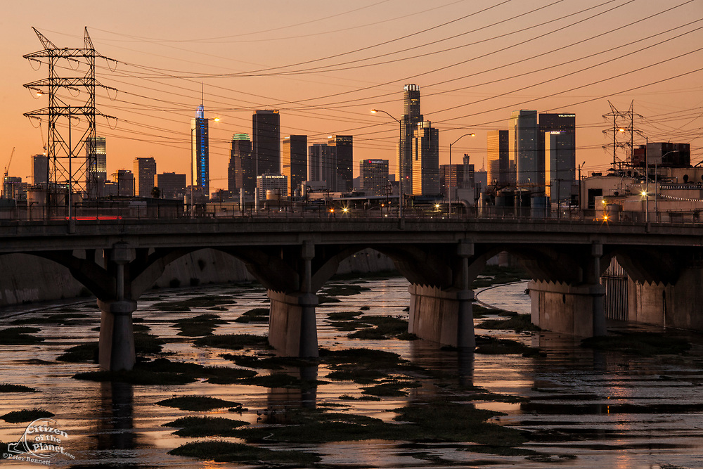The Los Angeles skyline and Los Angeles River from Vernon, a very industrial city in the shadow of downtown Los Angeles, California, USA
