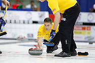 John Morris, third, on Kevin Martin'steam throws his rock in the team's first draw Wednesday.  The 2011 GP Car and Home Players' Championship ran April 12-17 at the Crystal Centre, Grande Prairie, AB..11-04-13, Photo Randy Vanderveen, Grande Prairie, Alberta.