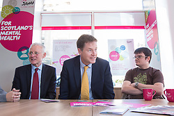 © Licensed to London News Pictures . 07/10/2014 . Glasgow , UK . EMBARGOED UNTIL 00:01 WEDNESDAY 08/10/2014 . Deputy Prime Minister Nick Clegg (c) visits the Scottish Association for Mental Health with Health Minister Norman Lamb (l) to meet with staff and service users and discuss mental health issues . The Liberal Democrat Party Conference 2014 at the Scottish Exhibition and Conference Centre in Glasgow . Photo credit : Joel Goodman/LNP