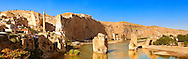 Remains of medieval Artukid Old Tigris Bridge – Built in 1116 by Artukid Fahrettin Karaaslan, the biggest in Anatolia at the time, with the old town Hasankeyf and its ruins on the cliffs abover the river Tigris. The minaret is of the El Rizk Mosque built 1409.  Turkey. 6 .<br /> <br /> If you prefer to buy from our ALAMY PHOTO LIBRARY  Collection visit : https://www.alamy.com/portfolio/paul-williams-funkystock/hasankeyf-turkey.html<br /> <br /> Visit our PHOTO COLLECTIONS OF TURKEY HISTOIC PLACES for more photos to download or buy as wall art prints https://funkystock.photoshelter.com/gallery-collection/Pictures-of-Turkey-Turkey-Photos-Images-Fotos/C0000U.hJWkZxAbg