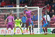Scunthorpe United defender Cameron Burgess (21)  clears ball from Rochdale forward Calvin Andrew (9)during the EFL Sky Bet League 1 match between Scunthorpe United and Rochdale at Glanford Park, Scunthorpe, England on 8 September 2018. Photo Ian Lyall