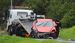 South Africa - Cape Town - 10 July 2020 - A red Porche is towed away from Camps Bay drive. Many road accidents have been reported during stormy conditions in Cape Town. Picture: Henk Kruger/African News Agency(ANA)