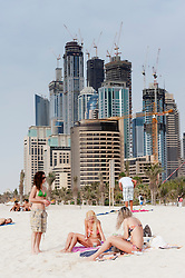 beach at Jumeirah Beach resort district with high rise buildings to rear in Dubai, United Arab Emirates,UAE