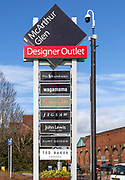 McArthur Glen designer outlet sign listing some of the shops, Swindon, Wiltshire, England, UK