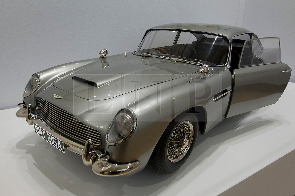 © Licensed to London News Pictures. 28/09/2012. LONDON, UK. A 1/3 scale replica of an Aston Martin DB5 used in the 2012 Daniel Craig Bond film 'Skyfall' (est. £30,000-60,000) is seen at the press view for the 50 Years of James Bond Auction in London today (28/09/12).  The auction, taking place on in two parts, an online sale on the 28th of September and an evening event on the 5th of October - Global James Bond Day -  is being held in aid of various charities and features props and costumes from 50 years of James Bond movies. Photo credit: Matt Cetti-Roberts/LNP