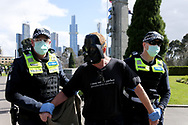 MELBOURNE, VIC - SEPTEMBER 05: A man in a Darth Vader mask is arrested during the Anti-Lockdown Protest on September 05, 2020 in Sydney, Australia. Stage 4 restrictions are in place from 6pm on Sunday 2 August for metropolitan Melbourne. This includes a curfew from 8pm to 5am every evening. During this time people are only allowed to leave their house for work, and essential health, care or safety reasons. (Photo by Dave Hewison/Speed Media)