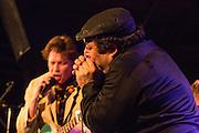 "Harmonica player ""Shaky"" Dave Pollack with Alex Battles."