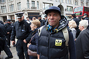 Musician Goldie makes a face to camera surrounded by police prior to a demonstration. Clifford Joseph Price (born 19 September 1965), better known as Goldie, is a British electronic music artist, DJ, visual artist and actor. He is well known for his innovations in the jungle and drum and bass music genres. He previously gained exposure for his work as a graffiti artist.