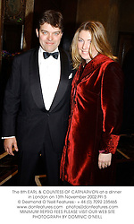 The 8th EARL & COUNTESS OF CARNARVON at a dinner in London on 13th November 2002.	PFI 5