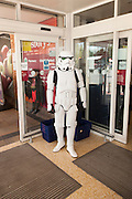 Person wearing white Imperial Stormtroopers Starwars costume in Sainsbury's supermarket, UK