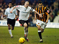 Photo: Leigh Quinnell.<br /> Luton Town v Hull City. Coca Cola Championship. 04/02/2006. Lutons Kevin Nicholls holds off Hulls Craig Fagan.