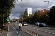 Cycle lane along the A38 Bristol Road on 26th October 2020 in Birmingham, United Kingdom. Birmingham Cycle Revolution's new blue cycle routes run in the north of Birmingham on the A34 and in the south on the A38, which provides an easy route between Selly Oak and the city centre.