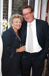 DAME VIVIEN DUFFIELD and LORD SAATCHI at a Conservative Party summer garden party hosted by Lord Hesketh and held at 7 Lansdowne Road, Notting Hill, London W11 on 28th June 2004.