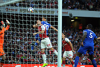 Football - 2017 / 2018 Premier League - Arsenal vs. Leicester City<br /> <br /> Shinji Okazaki of Leicester heads his goal past Petr Cech, at The Emirates.<br /> <br /> COLORSPORT/ANDREW COWIE