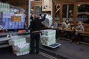 A delivery of toilet rolls being unloaded from the back of a van in Soho, central London