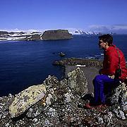 Antarctica, Aitcho Island. Antarctica Peninsula. Tourist enjoys view.