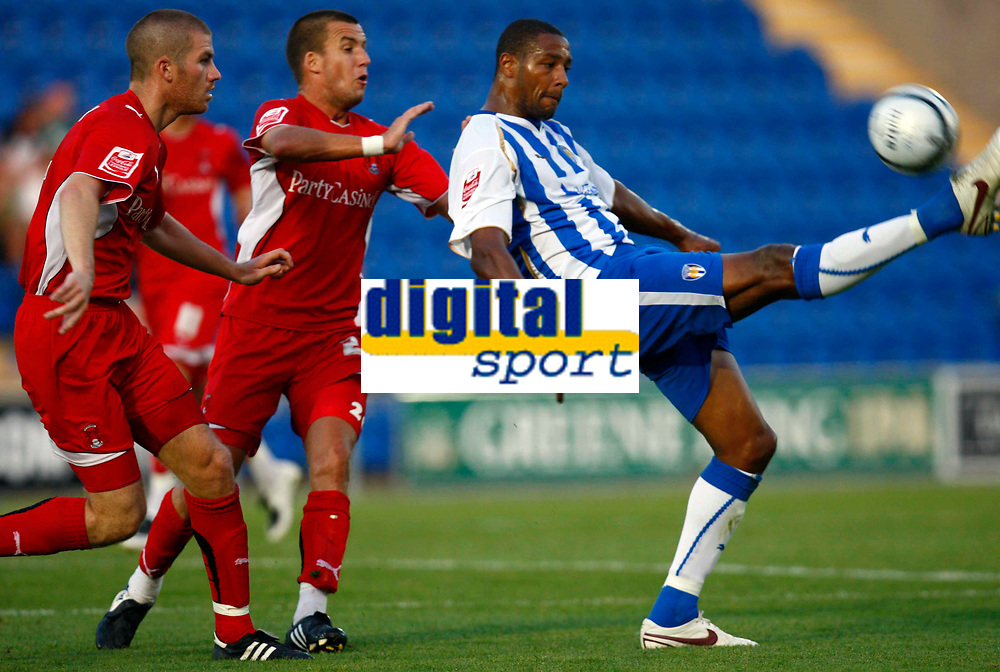 Football Carling Cup First Round Colchester United v Leyton Orient Clive Platt of Colchester United Ben Chorley and Jimmy Smith of Leyton Orient at Weston Homes Community Stadium, Colchester 11/08/2009 Credit: Colorsport / Kieran Galvin