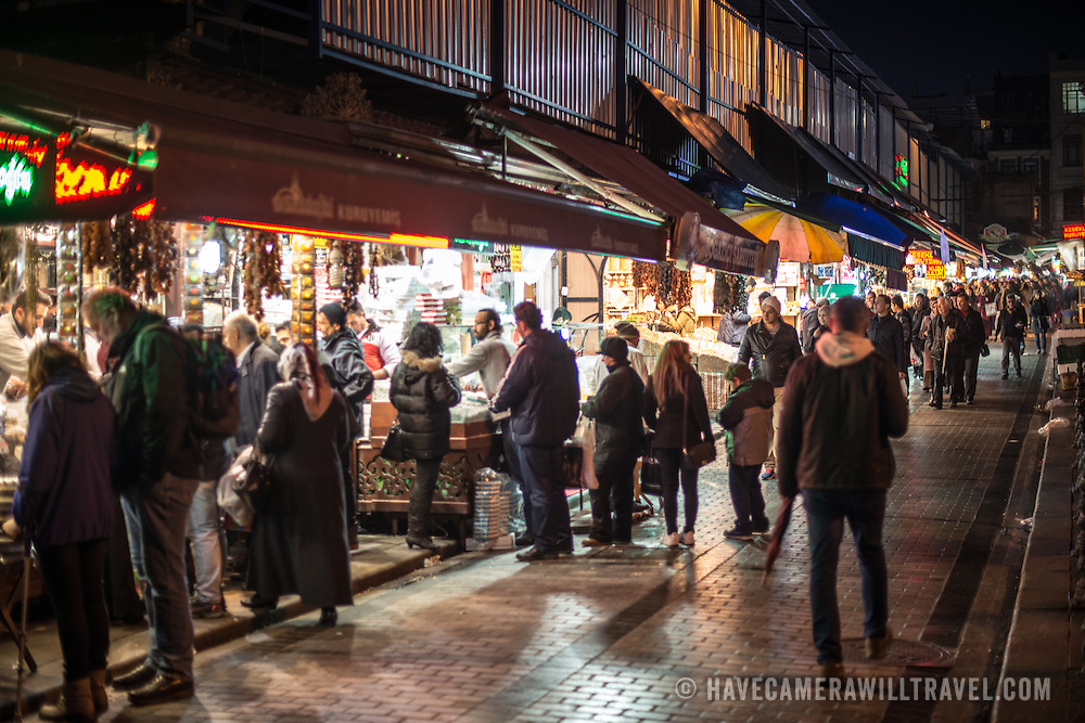 Shoppers crowd the stores on an outer wall of the Spice Bazaar in Istanbul. Located in the Eminonu quarter of Istanbul, next to the Galata Bridge, the Spice Bazaar is one of the city's largest and most famous markets. It is also known as the Egyptian Bazaar.