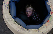 Trevor Simpson, 8, of Finley peers up from inside the barrel after helping with its preparation at the 2008 Horse Heaven Hills Round-Up rodeo.