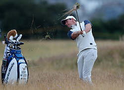 Northern Ireland's Rory McIlroy plays a shot from the rough during preview day four of The Open Championship 2018 at Carnoustie Golf Links, Angus.