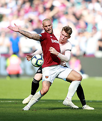 West Ham United's Marko Arnautovic (left) and Manchester United's Scott McTominay battle for the ball during the Premier League match at London Stadium.
