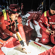 Leg 7 from Auckland to Itajai, day 12 on board MAPFRE, Antonio Cuervas-Mons warming up the glue, 30 March, 2018.