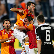 Galatasaray's Johan Elmander (R) with Emre Colak (C) Selcuk inan (L) and Besiktas's Tomas Sivok (R) celebrating his goal during their Turkish Superleague soccer derby match Besiktas between Galatasaray at the Inonu Stadium at Dolmabahce in Istanbul Turkey on Thursday, 26 August 2012. Photo by TURKPIX