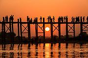 U Bein Bridge - the longest teak bridge (footbridge) in the world in Amarapura, Mandalay, Myanmar silhouetted at sunset