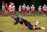 Tim Barton holds on to the catch during the Merrimack Valley versus Trinity Friday Night Football game.  (Karen Bobotas/for the Concord Monitor)Friday Night Football Merrimack Valley High School versus Trinity High School in Concord, NH September 2, 2011.  (Karen Bobotas/for the Concord Monitor)