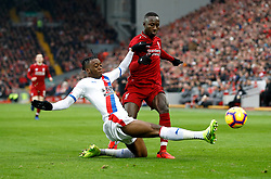 Crystal Palace's Aaron Wan-Bissaka (left) and Liverpool's Naby Keita battle for the ball during the Premier League match at Anfield, Liverpool.