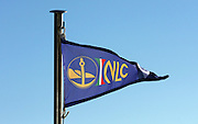 The flag and logo of 'Noutica Lago Como shipping company at Lake Como, Italy