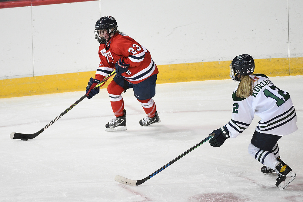 ERIE, PA - MARCH 05: Ellie Marcovsky #23 of the Robert Morris Colonials skates with the puck under pressure from Megan Korzack #12 of the Mercyhurst Lakers in the second period during the game at the Erie Insurance Arena on March 5, 2021 in Erie, Pennsylvania. (Photo by Justin Berl/Robert Morris Athletics)