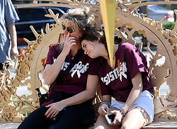 Cindy Damien cries as she sits with her daughter, Emma Stravitz, 15, a sophmore at MSD, as they visit The Temple of Time in Coral Springs, Fla. on Thursday, February 14, 2019. Photo by Taimy Alvarez/Sun Sentinel/TNS/ABACAPRESS.COM
