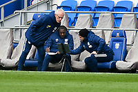 Football - 2020 / 2021 Sky Bet Championship - Cardiff City v Watford- Cardiff City Stadium<br /> <br /> Cardiff City manager Mick CcARTHY on the touchline looks at a screen after watford's equaliser with his assistants<br /> <br /> <br /> COLORSPORT/WINSTON BYNORTH