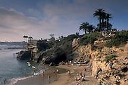 Coastal home over crowded sand beach, Corona del Mar, Newport Beach, California