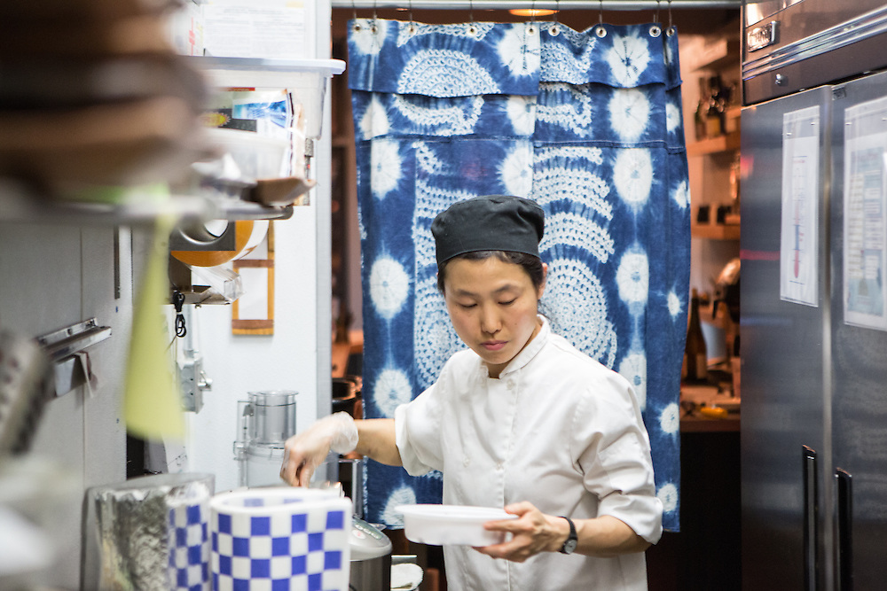Brooklyn, NY - 26 April 2014. Chef Haegeen Kim in the kitchen at Dotory, a Korean restaurant on Broadway in Brooklyn's Williamsburg neighborhood.