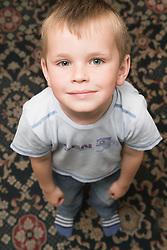 Portrait Young Polish boy looking upwards,