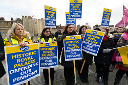 © Licensed to London News Pictures. 21/12/2018. London, UK.  Union members from the PCS unions stage a protest and picket line at the Tower of London, where some staff, including Beefeaters have walked out and are striking over changes to their defined benefits pension scheme. Historic Royal Palaces manages six of the UK's royal palaces, including the Tower of London, Kensington Palace and Hampton Court Palace where strike action is also taking place today. Photo credit: Vickie Flores/LNP