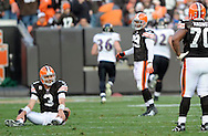 Cleveland quarterback Derek Anderson sits on the turf after throwing an interception that was returned 42 yards for a TD by Baltimore's Terrell Suggs late in the fourth quarter.