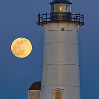 Pink full moon behind Nobska Lighthouse in Falmouth, Massachusetts on Cape Cod.<br /> <br /> Beautiful Massachusetts fine art photography of Nobska Lighthouse and full moon are available as museum quality photography prints, canvas prints, acrylic prints, wood prints or metal prints. Fine art prints may be framed and matted to the individual liking and interior design decorating needs:<br /> <br /> https://juergen-roth.pixels.com/featured/new-england-fine-art-photography-of-nobska-lighouse-juergen-roth.html<br /> <br /> Good light and happy photo making!<br /> <br /> My best,<br /> <br /> Juergen
