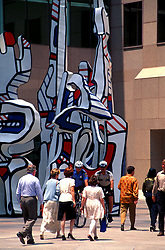 """Stock photo of business people in Houston Texas walking past downtown sculpture """"Monument Au Fantome"""" by Jean Dubuffet."""