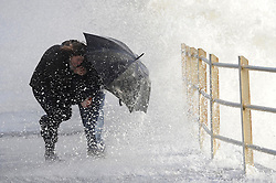 The Met Office a Red weather warning for Central Scotland today with high winds due at lunchtime as a hugh winter storm heads across Scotland.<br /> Fiona and Craig Wilson brave the waves at Ardrossan South Beach