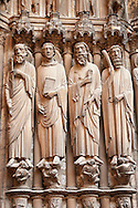 South Porch right jam. Cathedral of Chartres, France. Gothic statue of the Apostles (haloed, carrying the instruments of their deaths). From left to right they are Paul (characteristic facial features, carrying a sword) , John (beardless, carrying a book and what Houvet says is part of a palm frond) , James Major (carrying a sword and a pilgrim's pouch) , James Minor (carrying a club) , Bartholomew. On the socles on which they stand are their persecutors, mostly crowned figures holding scrolls and looking upward. A UNESCO World Heritage Site. .<br /> <br /> Visit our MEDIEVAL ART PHOTO COLLECTIONS for more   photos  to download or buy as prints https://funkystock.photoshelter.com/gallery-collection/Medieval-Middle-Ages-Art-Artefacts-Antiquities-Pictures-Images-of/C0000YpKXiAHnG2k