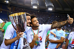 August 13, 2017 - Rome, Italy - Felipe Anderson of Lazio and Luis Alberto of Lazio taking a selfie with the cup after winning the Italian SuperCup TIM football match Juventus vs Lazio on August 13, 2017 at the Olympic stadium in Rome. (Credit Image: © Matteo Ciambelli/NurPhoto via ZUMA Press)
