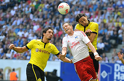 Football: Germany, Liga Total Cup, Hamburger SV - Borussia Dortmund, Hamburg, 04.08.2012.form left: Mats Hummels (Dortmund), Marcell Jansen (HSV) und Neven Subotic (Dortmund).©Êpixathlon