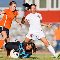 100212       Cable Hoover<br /> <br /> Gallup Bengal goalie Danitza Zavala (44) dives between Grants Pirate Danielle Rael (4) and Gallup Bengal Saryah Martinez (7) for a stop Tuesday at Gallup High School.