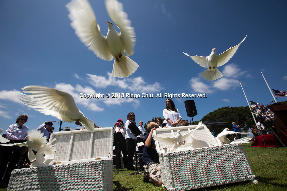Doves are released during the Memorial Day Observance Monday, May, 27, 2013, at Green Hills Memorial Park in Rancho Palos Verdes, California.(Photo by Ringo Chiu/PHOTOFORMULA.com).