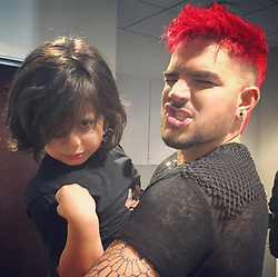 """Adam Lambert releases a photo on Instagram with the following caption: """"Backstage w the one and only Riff Cherry"""". Photo Credit: Instagram *** No USA Distribution *** For Editorial Use Only *** Not to be Published in Books or Photo Books ***  Please note: Fees charged by the agency are for the agency's services only, and do not, nor are they intended to, convey to the user any ownership of Copyright or License in the material. The agency does not claim any ownership including but not limited to Copyright or License in the attached material. By publishing this material you expressly agree to indemnify and to hold the agency and its directors, shareholders and employees harmless from any loss, claims, damages, demands, expenses (including legal fees), or any causes of action or allegation against the agency arising out of or connected in any way with publication of the material."""